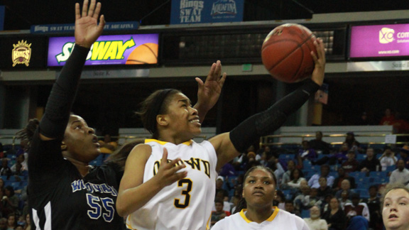 Ariell Bostick of Bishop O'Dowd beats Kristen Simon of Windward on a drive to the basket during CIF Open Division final Saturday in Sacramento. Bostick led the Dragons with 17 points in 60-45 win. Photo: Willie Eashman.