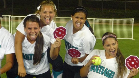 Four of Santiago's graduating seniors, including 30-game winning pitcher Erica Romero (far right), show off their goofy side during post-game photo after Saturday's CIFSS D1 final. Photo: Mark Tennis.