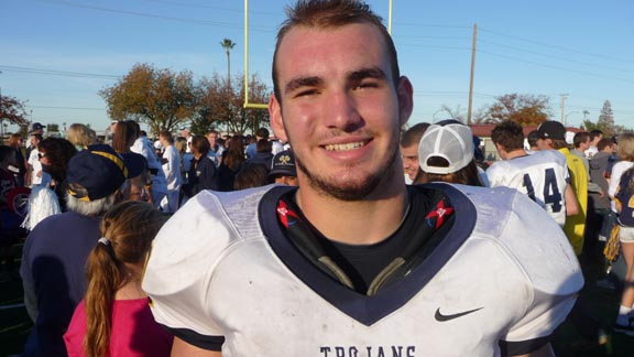 Fullback Tanner Hughes scored three touchdowns for Oak Ridge in its section semifinal win against Pleasant Grove and also shined last year as a junior (above) when the Trojans beat Burbank of Sacramento (when Burbank was 12-0) in the section semifinals. Photo: Mark Tennis.