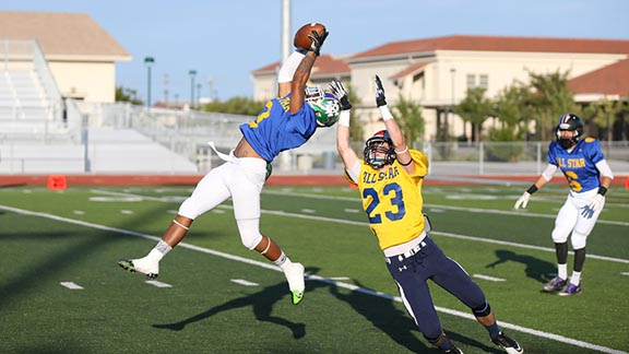 Bryan Pascual of the North team comes up with an interception on the first play run by the South team during Saturday's Lions All-Star Classic in Tracy. Photo: Stu Jossey Photography.