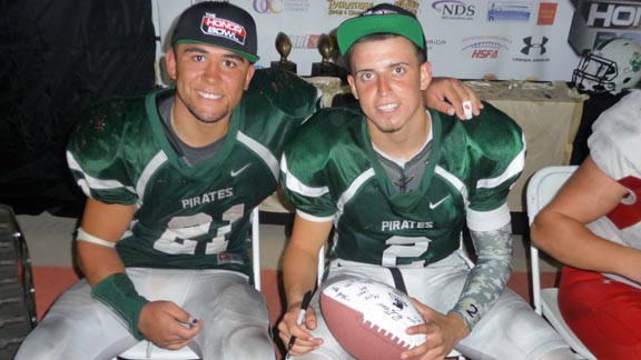 Both Josh Barnard (left) and Matt Romero signed balls and collected gear after Oceanside topped Mission Viejo during Friday's U-T Honor Bowl. Photo: Mark Tennis.