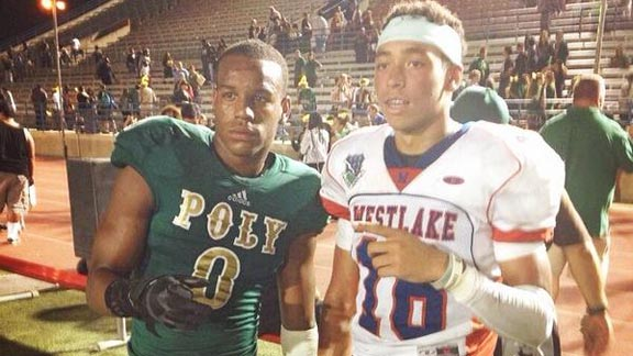 Malik Henry (right) may be playing for Long Beach Poly this season. He posed for photo after game last year with graduated Jackrabbit All-American Iman Marshall.  Photo: D1Bound.com (via Twitter).