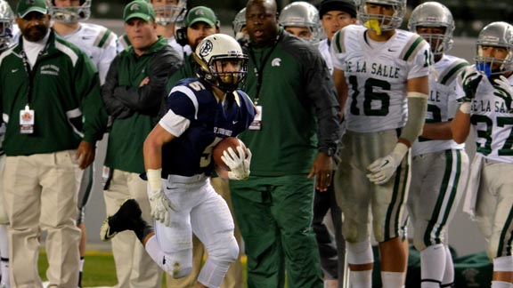 St. John Bosco's Sean McGrew flies down the sidelines in front of the Concord De La Salle bench in last December's CIF Open Division state final. Head coach Justin Alumbaugh is directly behind McGrew's left shoulder. Photo: Scott Kurtz.