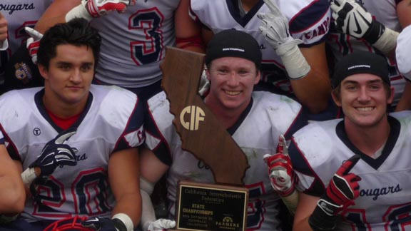 Adam Remotto (holding trophy) was the hero for Campolindo in win over El Capitan for D3 state title with an 84-yard fumble return TD with 51 seconds left. Photo: Mark Tennis.