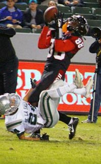 Javon McKinley makes one of his two TD catches for Corona Centennial against De La Salle. He also scored on a 92-yard kickoff return. Photo: Phillip Walton/SportStars.