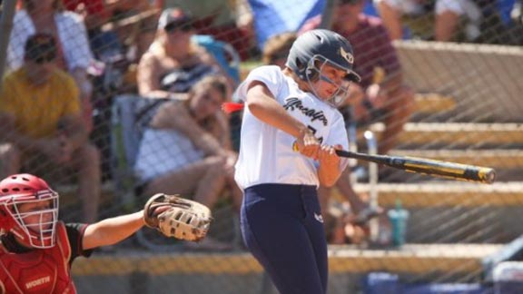 A Yucaipa hitter has made contact with a pitch thrown by Mission Viejo's Taylor McQuillin during title game of Michelle Carew Classic. Photo: Patrick Takkinen/OCSidelines.com.