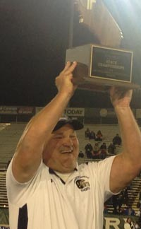Central Catholic head coach Roger Canepa hoists fourth consecutive CIF state title. Photo: Paul Muyskens.