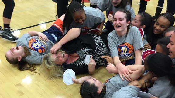 Chaminade head coach Kelli DiMuro wasn't shy about rolling on the floor as part of dog pile after team won second straight CIFSS Open Division title. Photo: Harold Abend.
