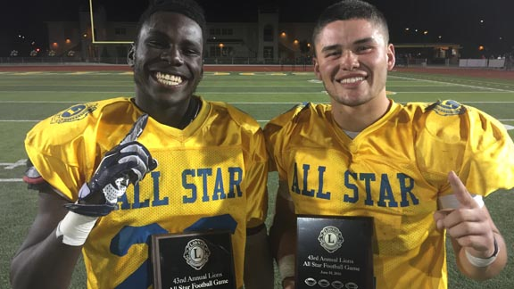 Tyran Daniels of Modesto Downey and Adam Herrera of Los Banos led the South team to a 28-20 win over the North in 43rd Lions All-Star Game in Tracy. Photo: Mark Tennis.