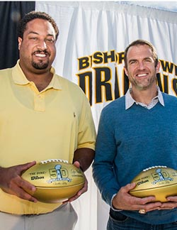 Langston Walker and Eric Bjornson received golden footballs that were given to O'Dowd earlier this year in celebration of the 50th Super Bowl. They both played in the game. Photo: bishopodowd.org.
