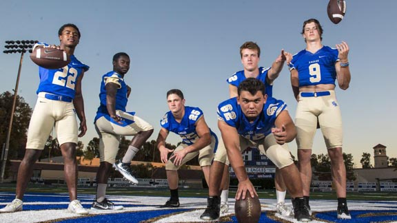 This group of Santa Margarita players, including Malone Mataele (22) and Grant Calcaterra (9), is up to No. 19 in this week's state rankings. Photo: @SMCHS_Football/Twitter.com.